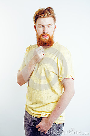 Young handsome hipster bearded guy looking brutal isolated on white background, lifestyle people concept Stock Photo