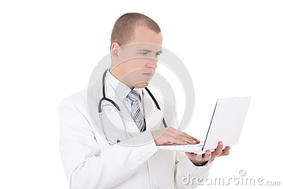 Young handsome male doctor using laptop isolated on white