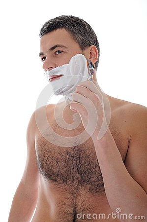 Young handsome male shaving face beard