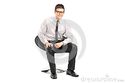 A young handsome male sitting on a chair