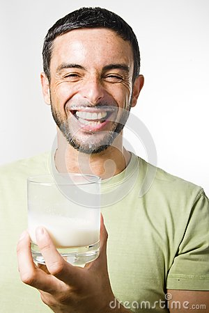 Young Handsome Man with Beard drinking Milk