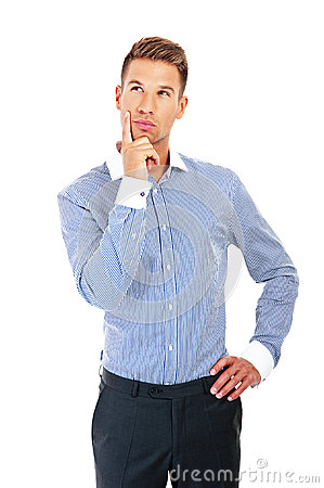 Young handsome man in blue shirt looking at copy-space thinking