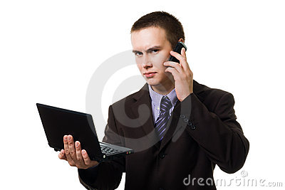 Young handsome man with cell phone and laptop