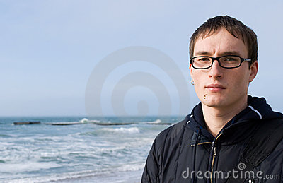 Young handsome man in glasses against a background
