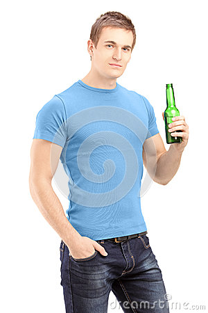 Young handsome man holding a bottle of beer