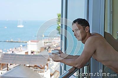 Young handsome man at hotel at tropics