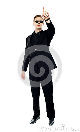 Young handsome man pointing upwards