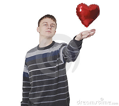 Young handsome man with red heart balloon