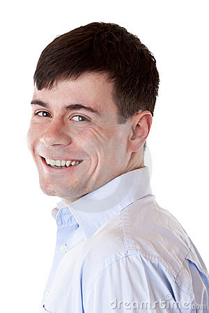 Young handsome man smiles happy at camera