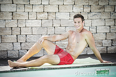 Young handsome man on swimming pool
