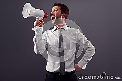 Shouting man using megaphone