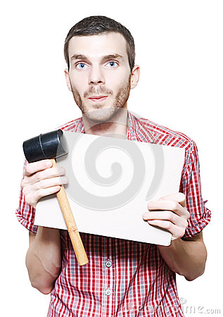 Young Handyman Holding Card Board Sign And Mallet