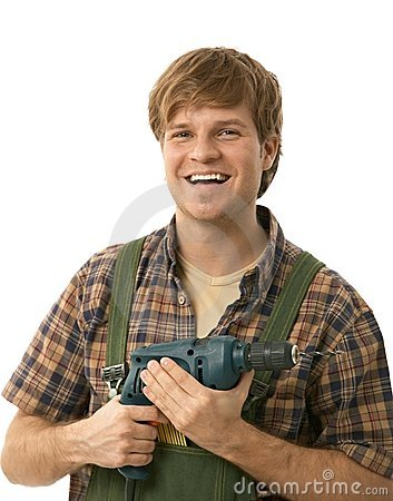 Young handyman holding power drill