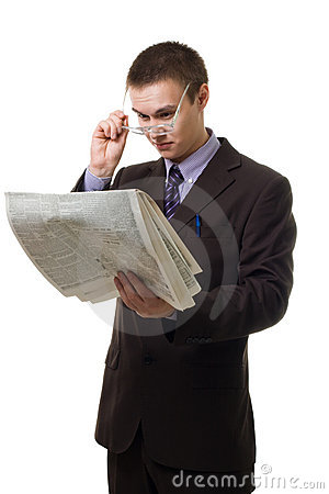 Young hansome man in suit with newspaper