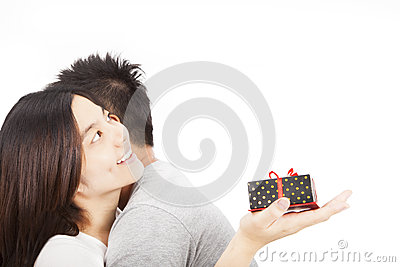 Young happy asian  couple with gift
