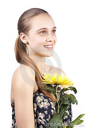 Young happy beautiful woman with yellow flower
