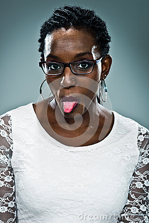 Free Young Happy Black Woman Sticking Out Her Tongue Stock Image - 29680351