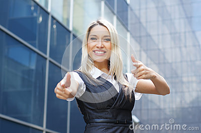 A young and happy blond Caucasian businesswoman