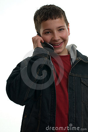 Young happy boy with mobile phone