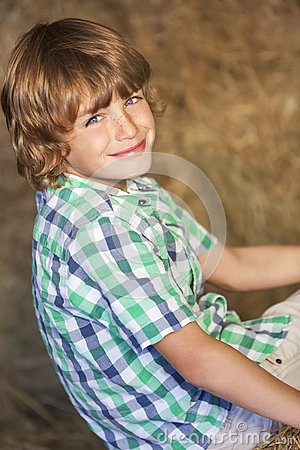 Free Young Happy Boy Smiling On Hay Bales Royalty Free Stock Image - 60499856