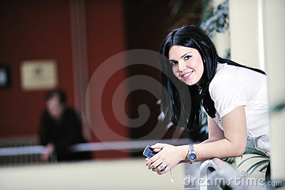 Young happy business woman talking by cellphone