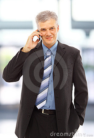 Young happy businessman calling