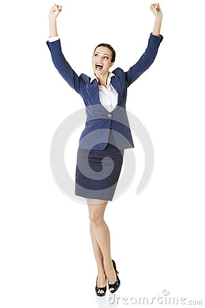 Young happy businesswoman with hands up