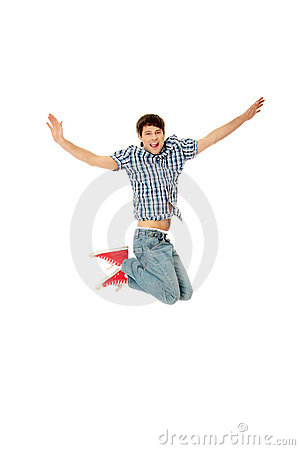 Young happy caucasian man jumping in the air