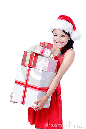Young happy Christmas girl holding huge gift