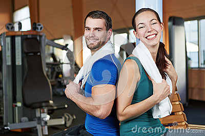 Young happy couple in fitness