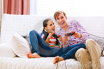 Young happy couple playing console Stock Photo