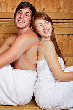 Young happy couple in sauna