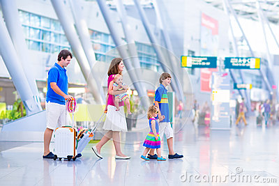 Young happy family at the airport