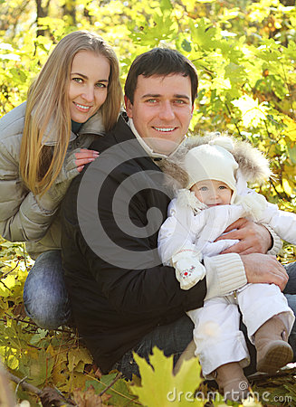 Young happy family in autumn park
