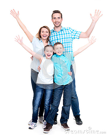 Young happy family with children raised hands up