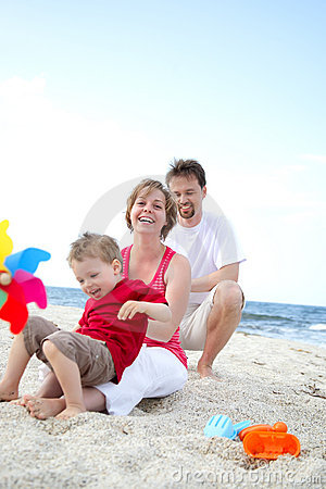 Free Young Happy Family On The Beach Stock Images - 9220014