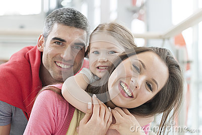 Young happy family in shopping mall
