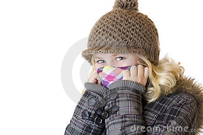 Young happy  girl with cap, scarf and jacket
