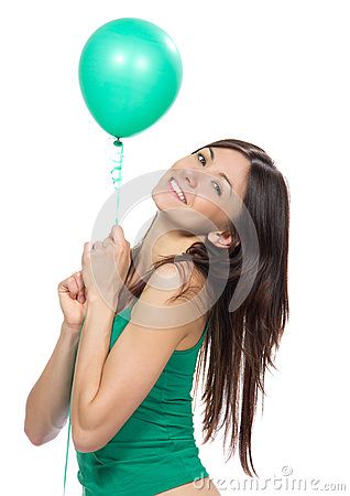 Young happy girl with green balloon