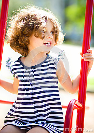 Free Young Happy Girl Is Swinging In Playground Royalty Free Stock Images - 47079379