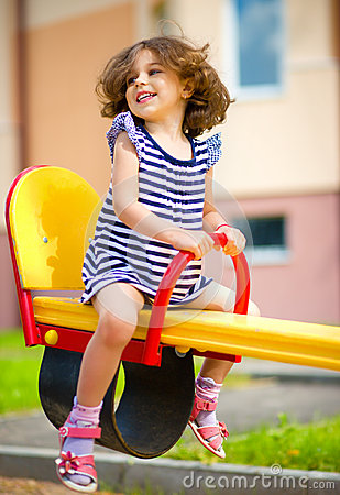 Free Young Happy Girl Is Swinging In Playground Royalty Free Stock Photo - 47079405