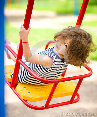 Free Young Happy Girl Is Swinging In Playground Stock Images - 47079414
