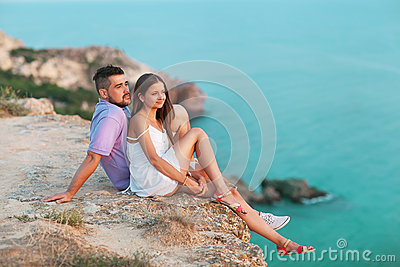 Young happy interracial couple on beach
