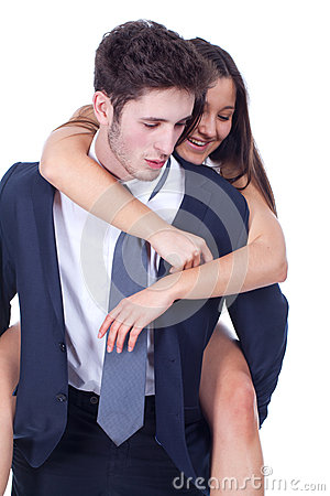 Young happy latin couple playing together piggyback