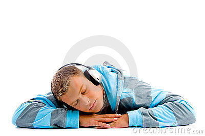 Young happy male with headphones and thumbs up