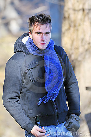Young happy man with scarf