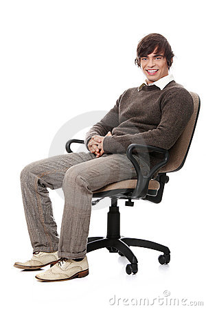 Young happy man sitting on a wheel chair.