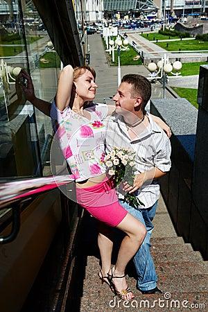 Young happy man and woman at romantic walk