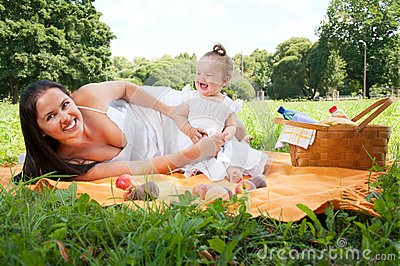 Young happy mother with daughter in the park