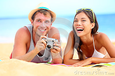 Young happy multicultural couple on beach